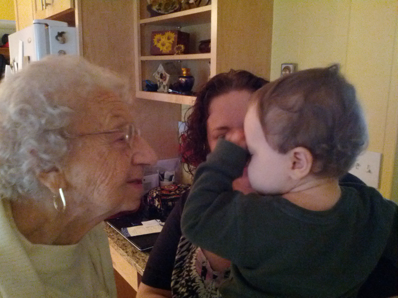 My grandmother visiting with her my son.